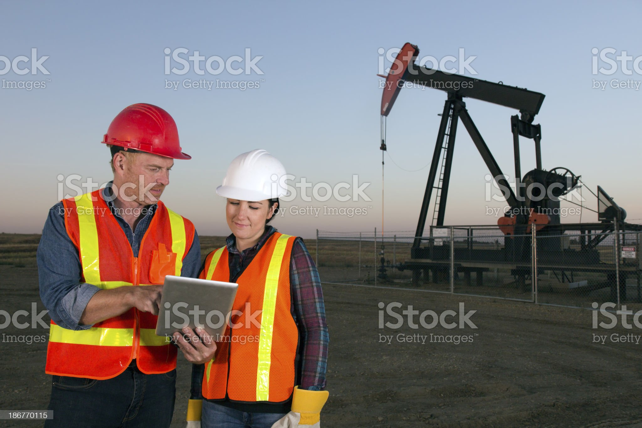 Oil Workers and Pumpjack royalty-free stock photo