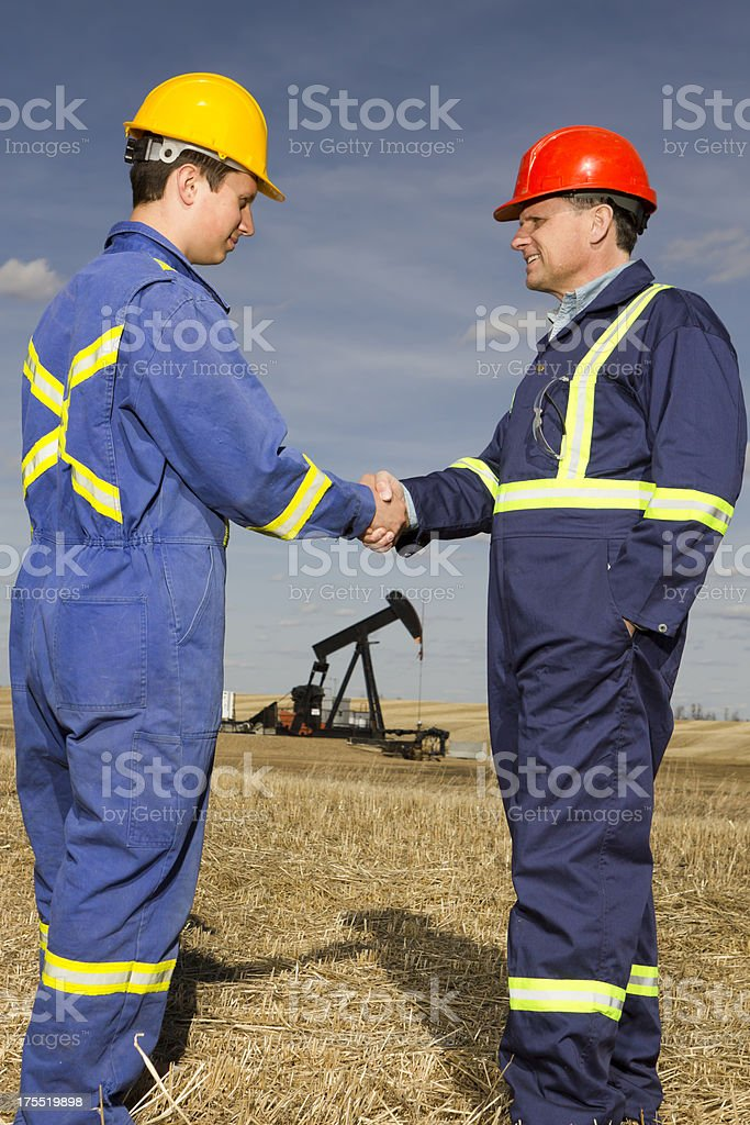 Oil Workers Handshake royalty-free stock photo