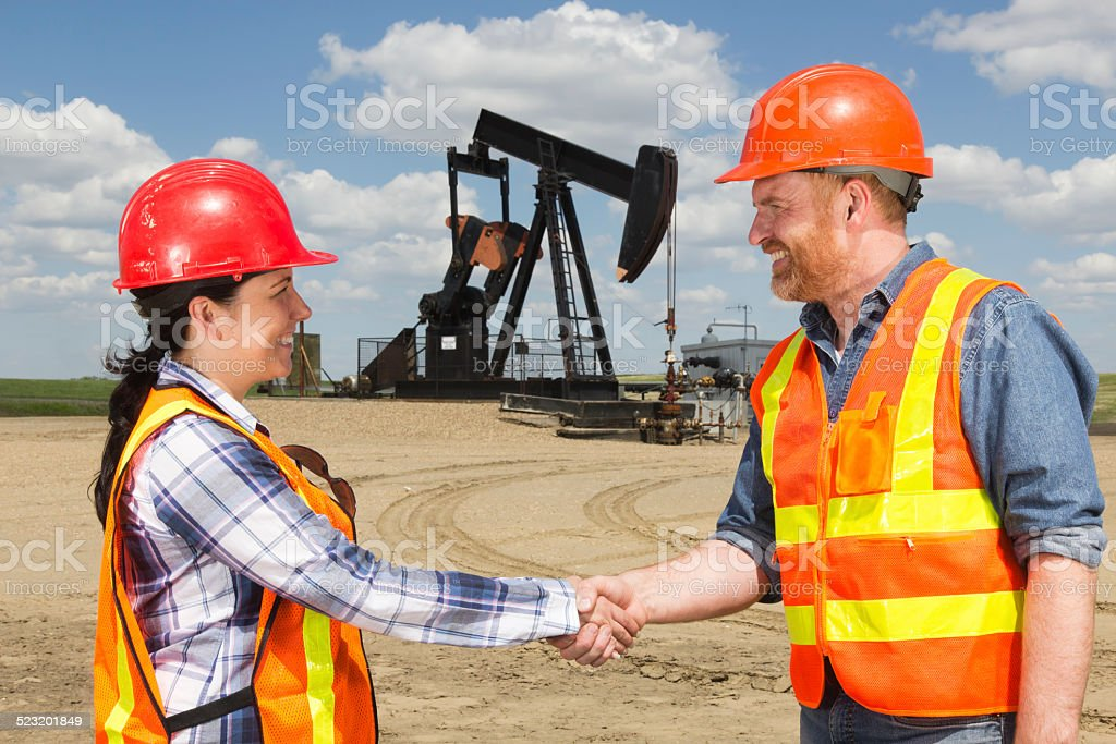Oil Workers Handshake stock photo