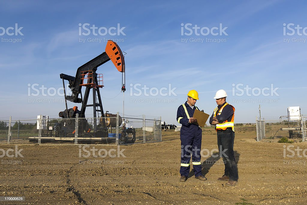 Oil Workers in Conversation stock photo