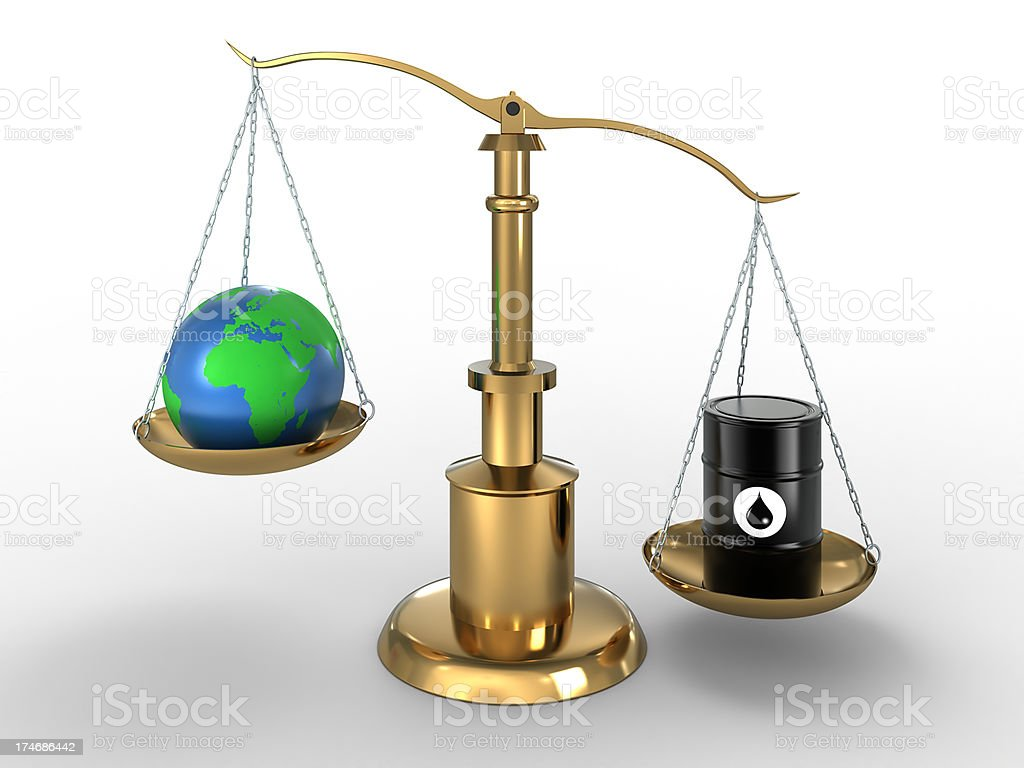 Oil worth more than world, on scales (Clipping Path included) royalty-free stock photo