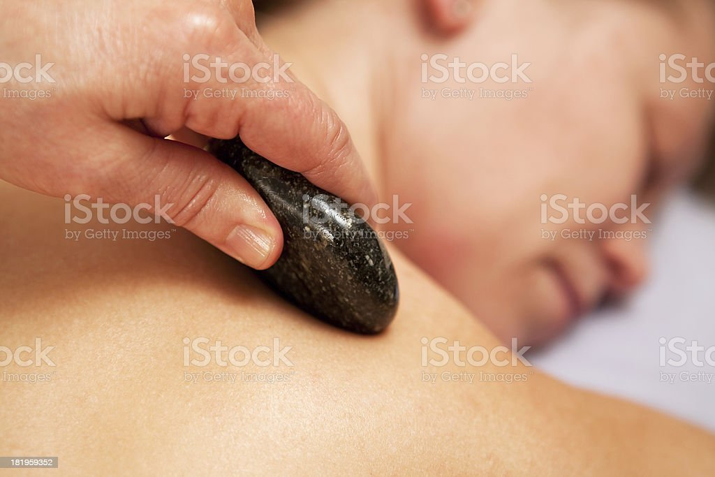 Oiled Hot Stone Shoulder Massage royalty-free stock photo