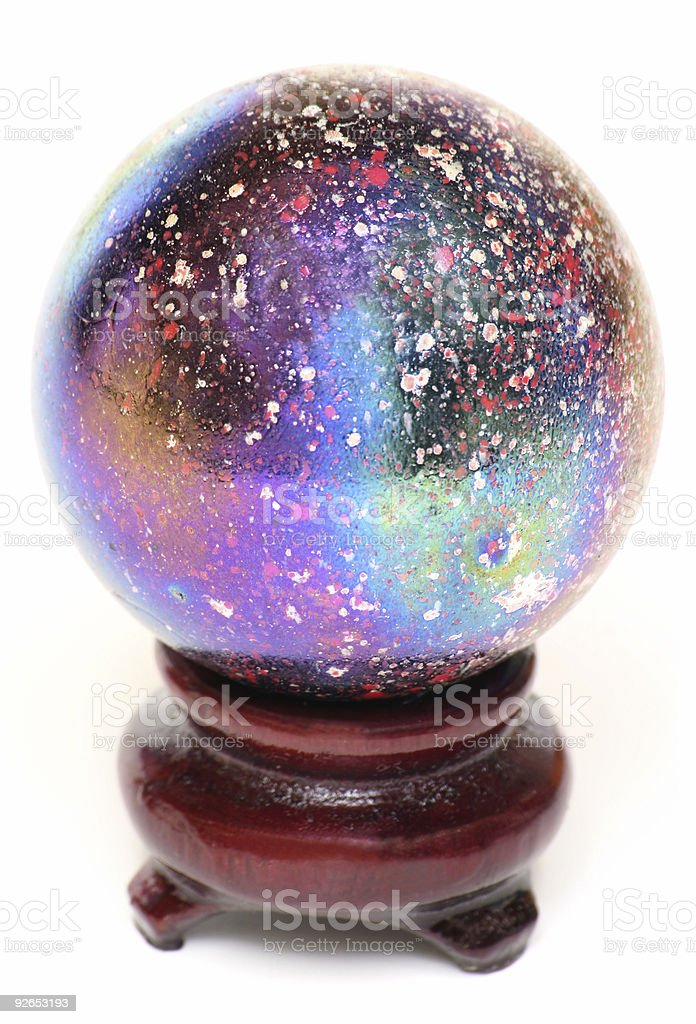 Oiled Metallic Glass Marble on a Stand stock photo