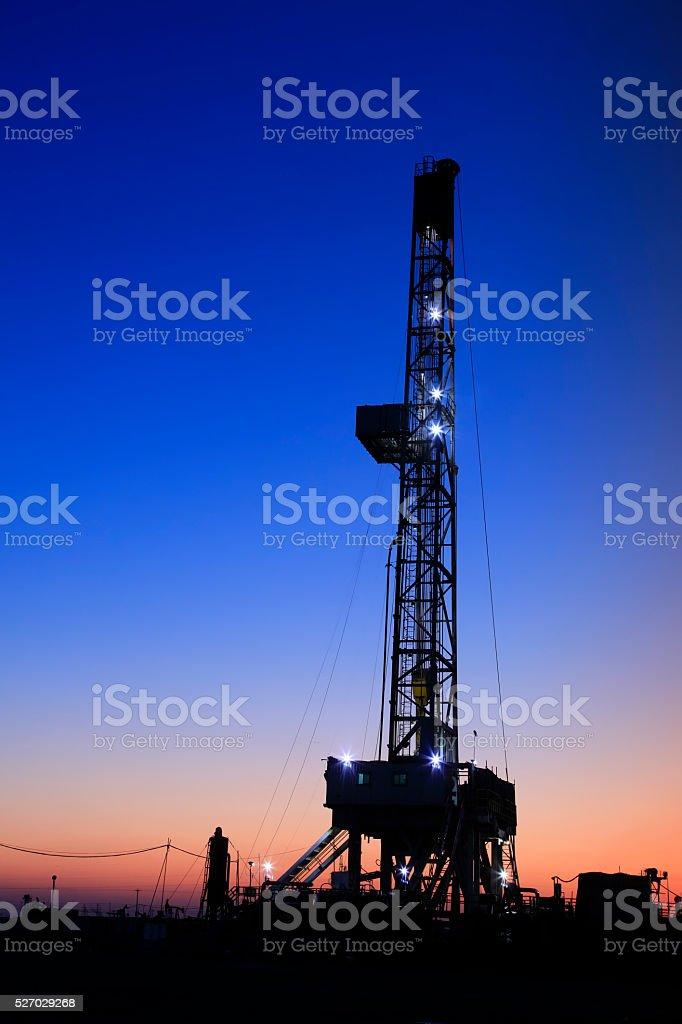 oilfield derrick at night stock photo