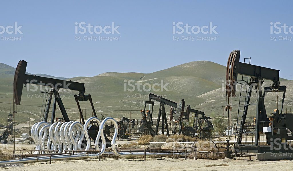 Oilfield in California with Multiple Wellhead Pumps royalty-free stock photo