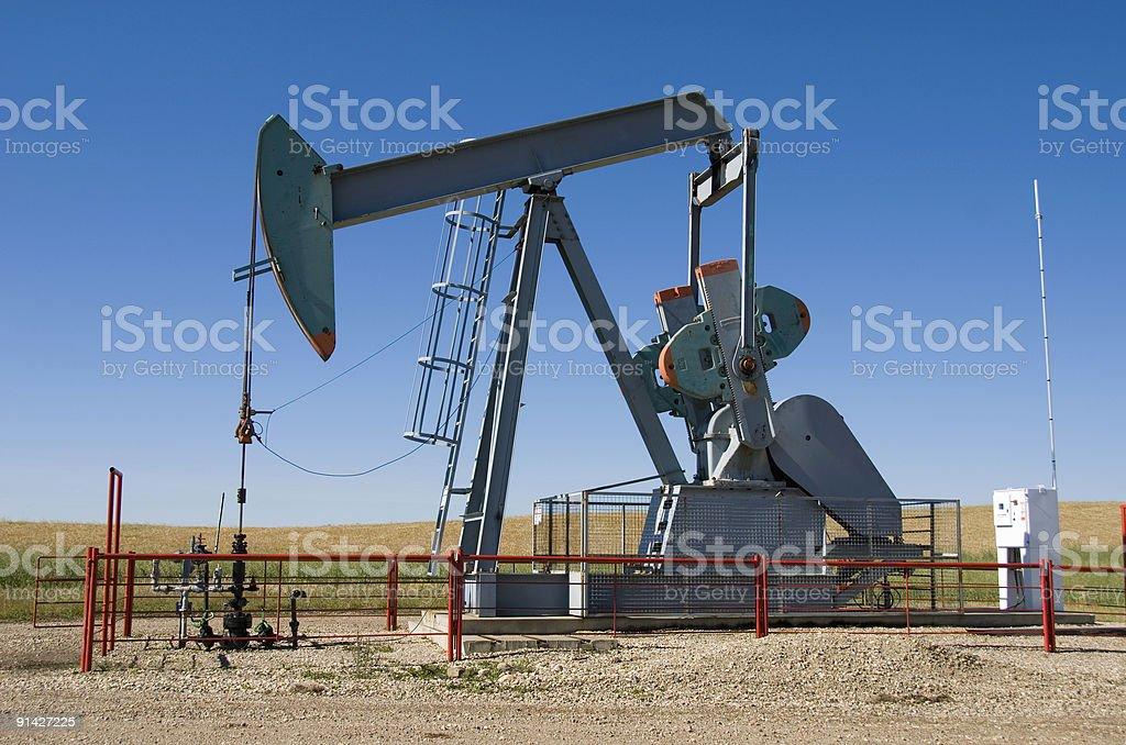Oilfield pump jack on prarie royalty-free stock photo