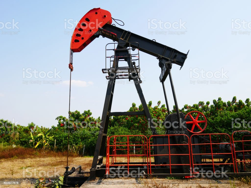 Oilfield Pump jack (rocking horse or pumpjack) stock photo