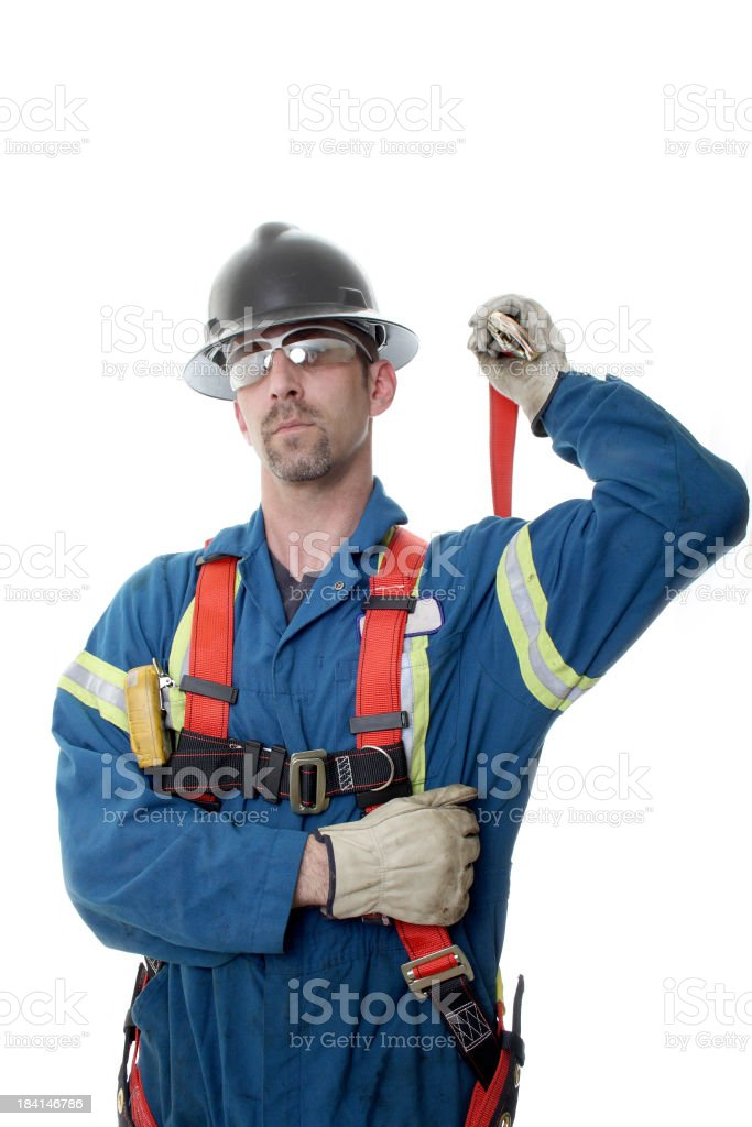 Oilfield worker safely dressed with hard hat and coveralls stock photo