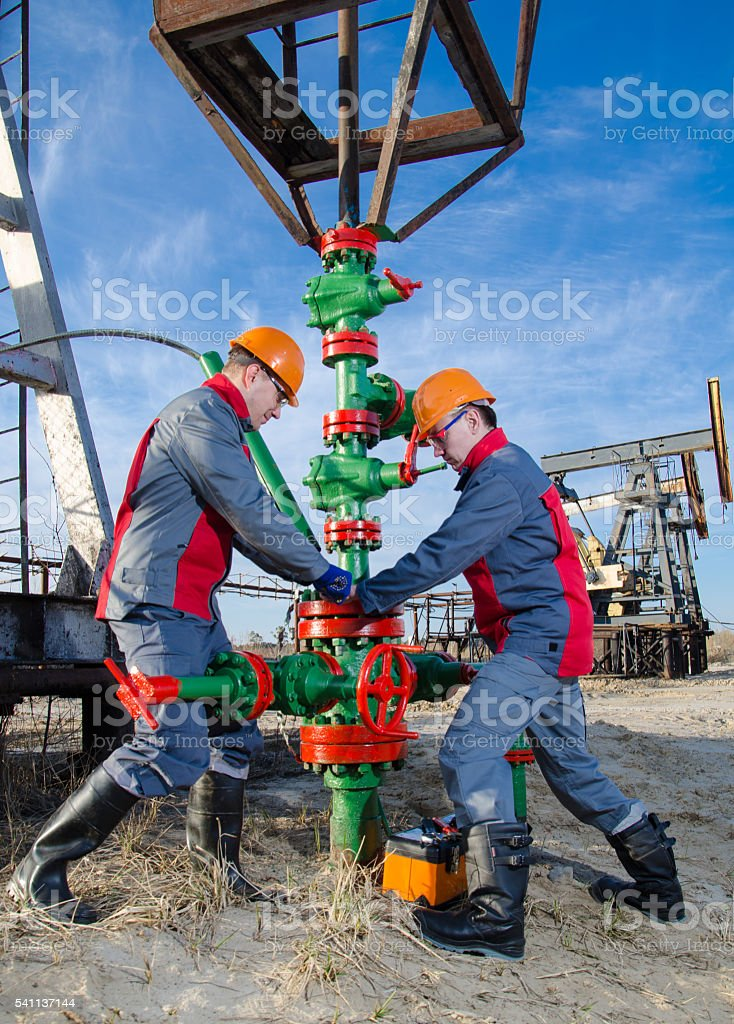 Oilfield workers stock photo