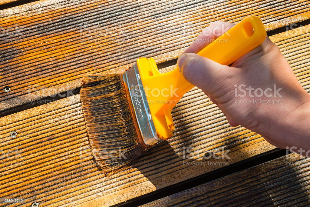 Oiling Terrace with Wide Brush stock photo