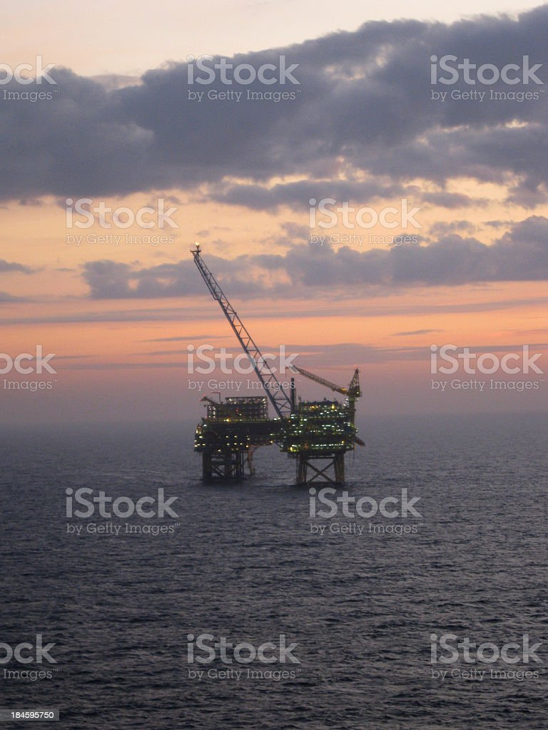 Oilrig at dawn stock photo
