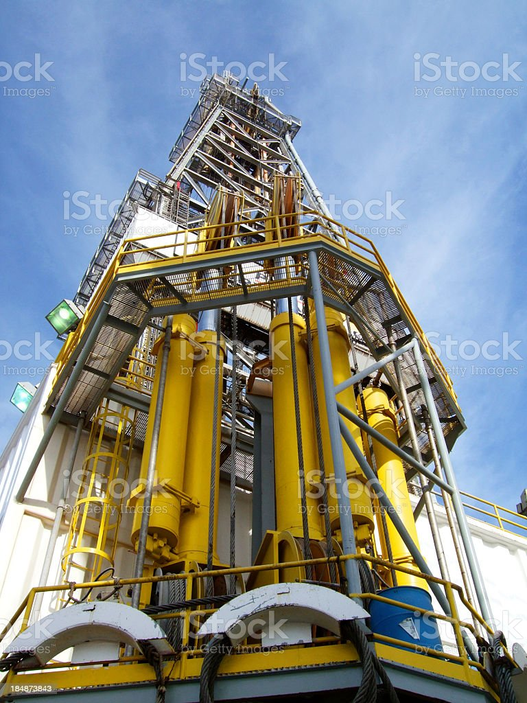 Oilrig compensators and derrick royalty-free stock photo