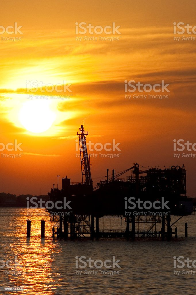 Oilrig in the sunset royalty-free stock photo