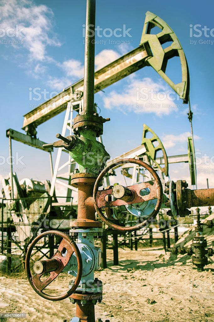 Oilwell and pump jack. stock photo