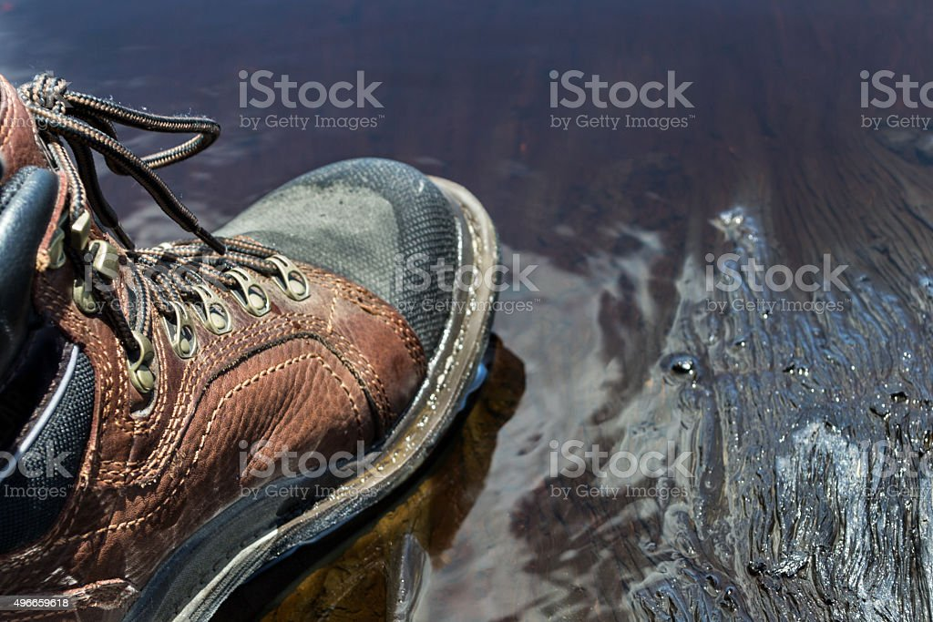 Oily working boot royalty-free stock photo