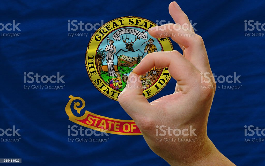ok gesture in front of idaho us state flag stock photo