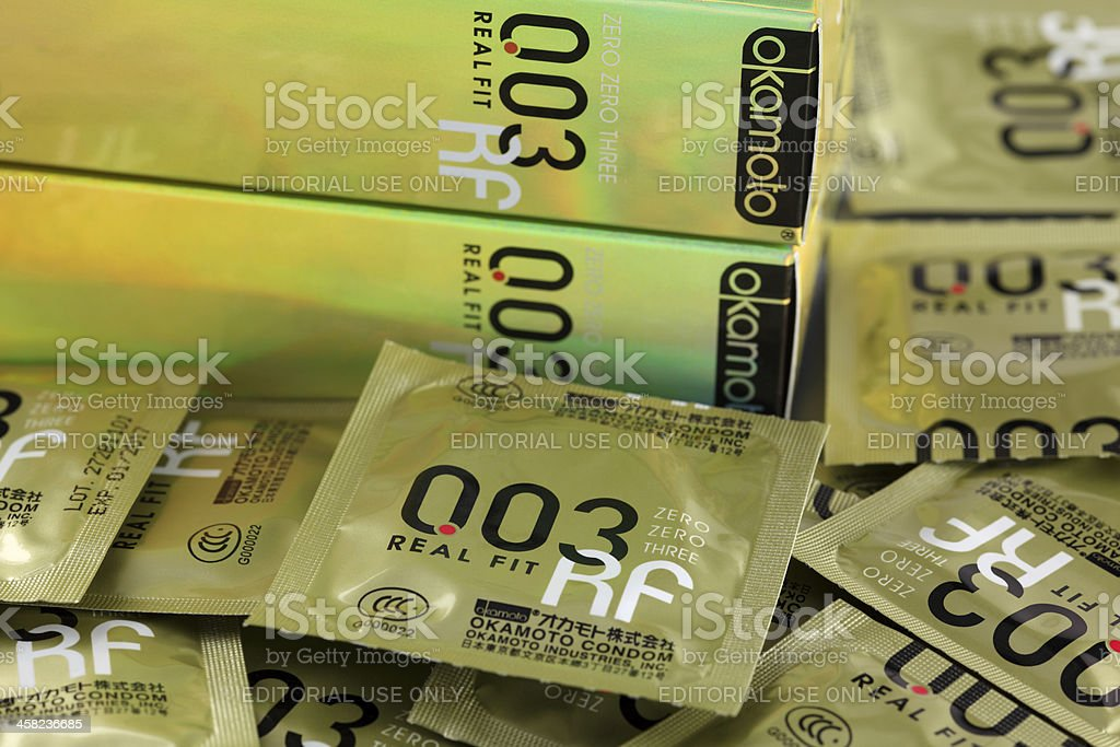 Okamoto 003 Real Fit condoms with boxes. stock photo