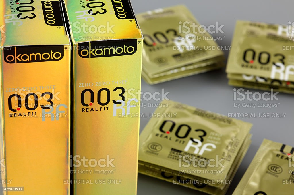 Okamoto 003 Real Fit condoms with boxes stock photo