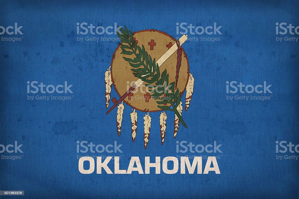 Oklahoma flag on fabric texture,retro vintage style stock photo