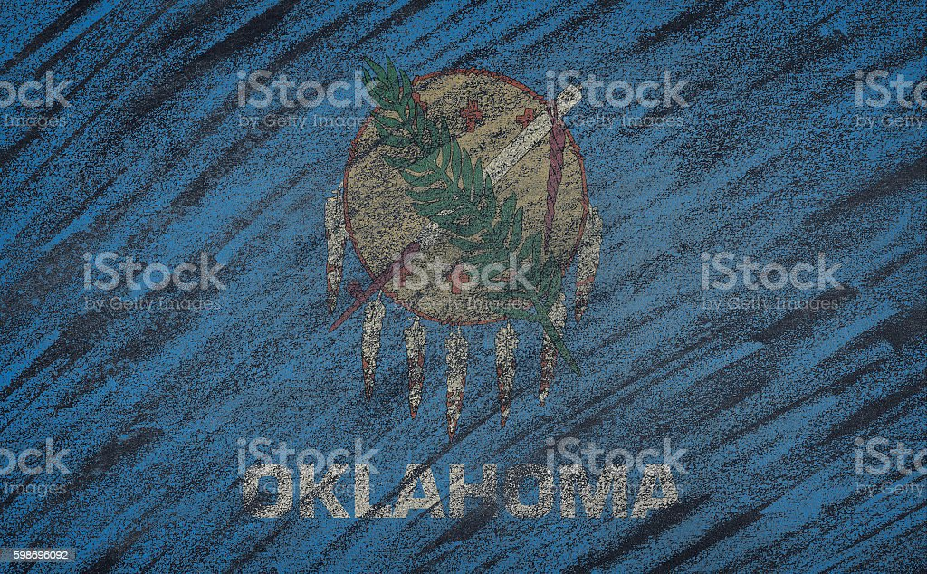 Oklahoma flag painted with colored chalk on a blackboard. stock photo