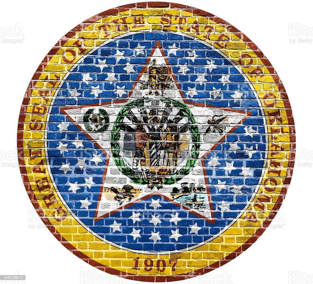Oklahoma Seal US flag painted on old vintage brick wall stock photo