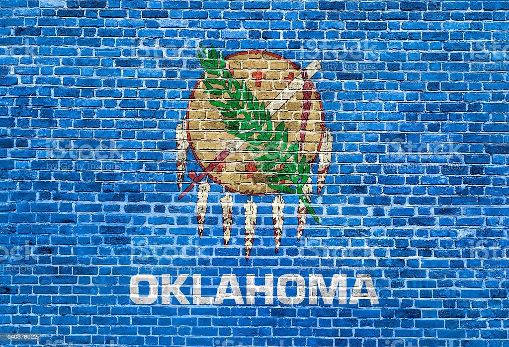 Oklahoma US flag painted on old vintage brick wall stock photo