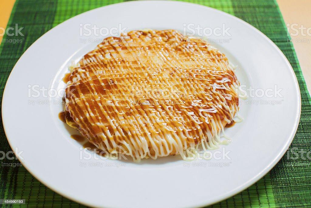 okonomi yaki- Japanese tradional pancake stock photo