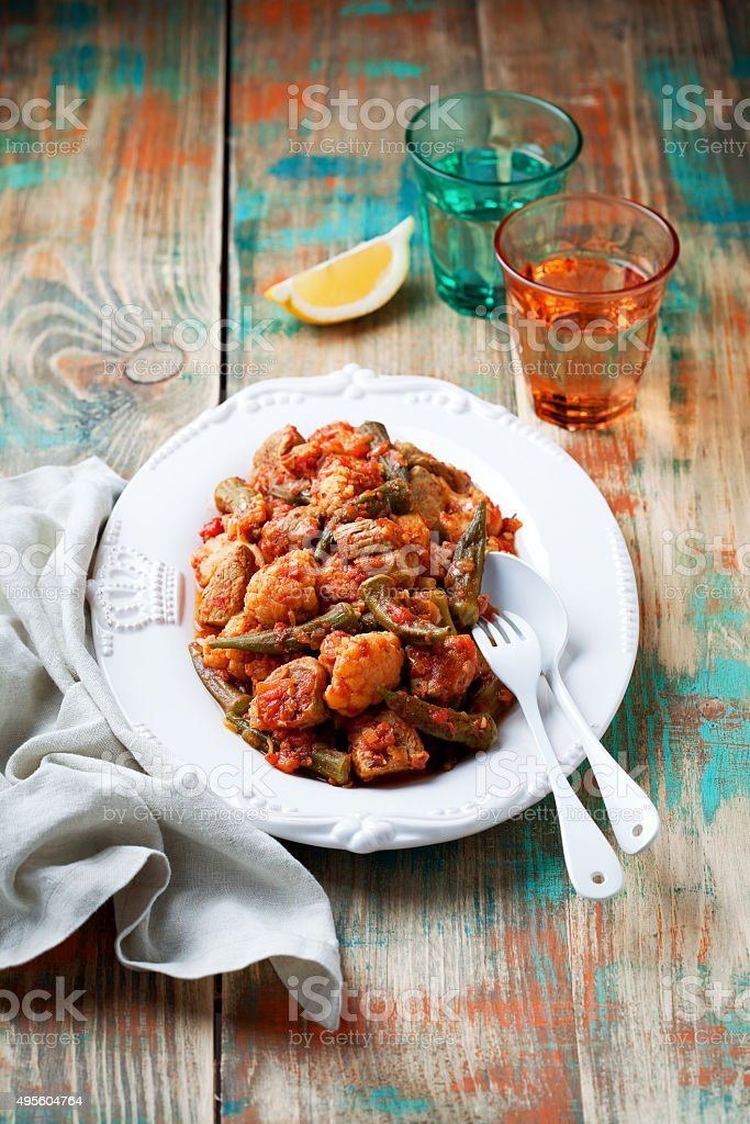 Okra, vegetables and meat ragout stock photo