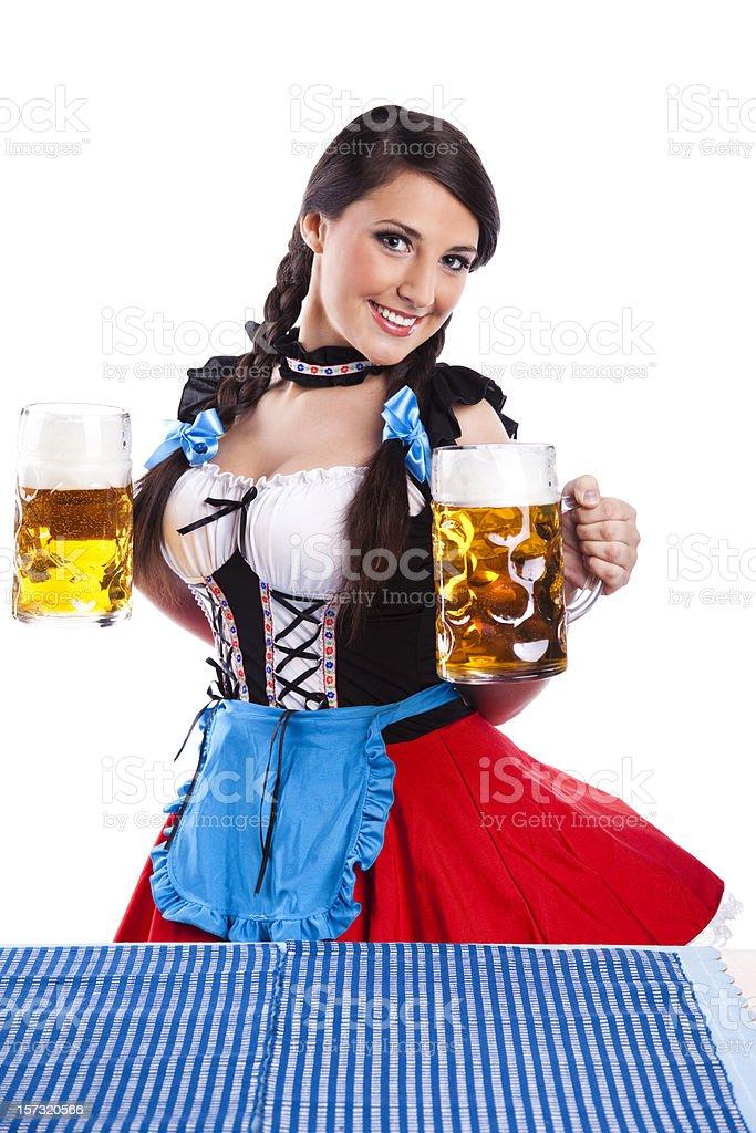Oktoberfest Bavarian girl with beers stock photo