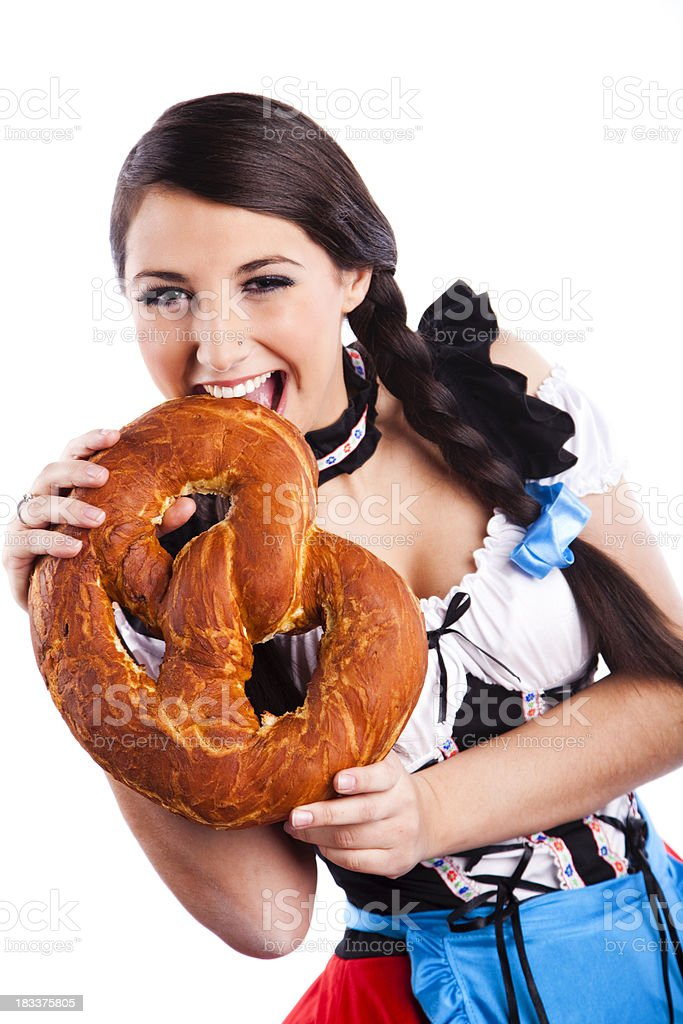 Oktoberfest Bavarian girl with pretzel royalty-free stock photo