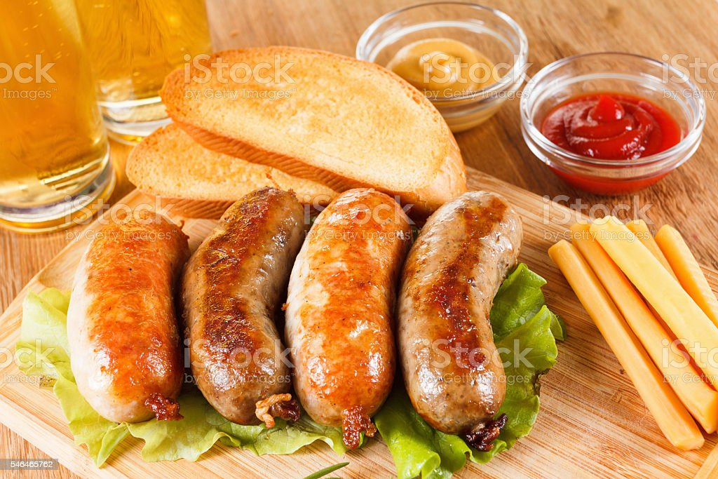 Oktoberfest Beer and roast beef and chicken sausage stock photo