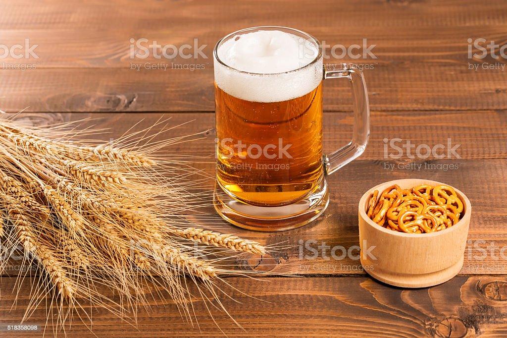 Oktoberfest Beer Mug and traditional German pretzels stock photo