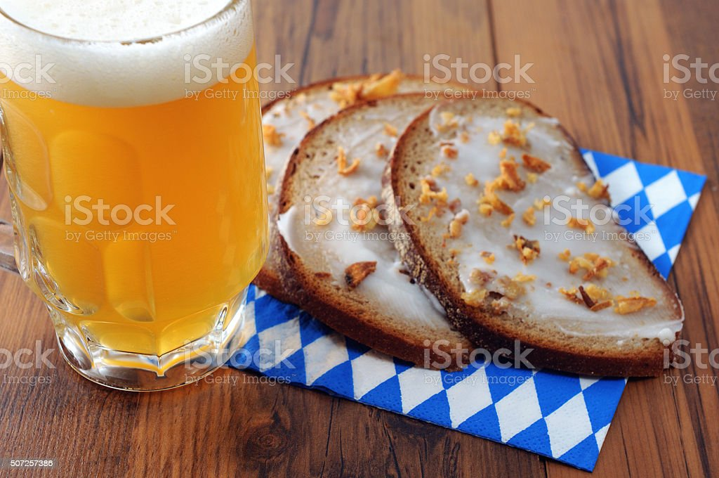 Oktoberfest decoration with beer and bread on bavarian napkin stock photo