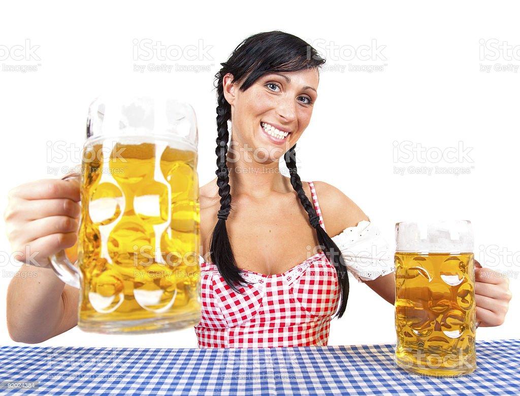 oktoberfest dirndl wearing woman with stein beer royalty-free stock photo