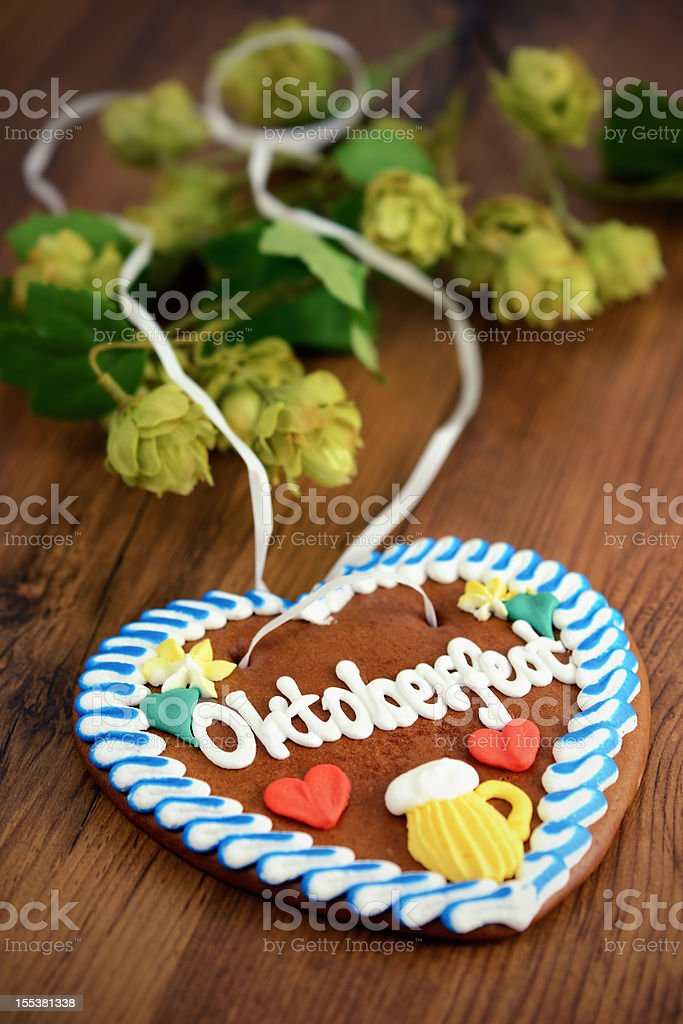 Oktoberfest Gingerbread Cookie on table with hop royalty-free stock photo