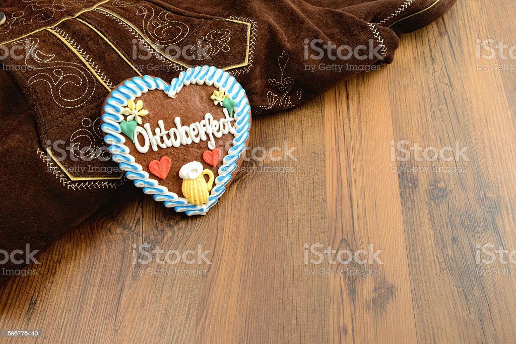 Oktoberfest gingerbread heart and bavarian leather pants stock photo