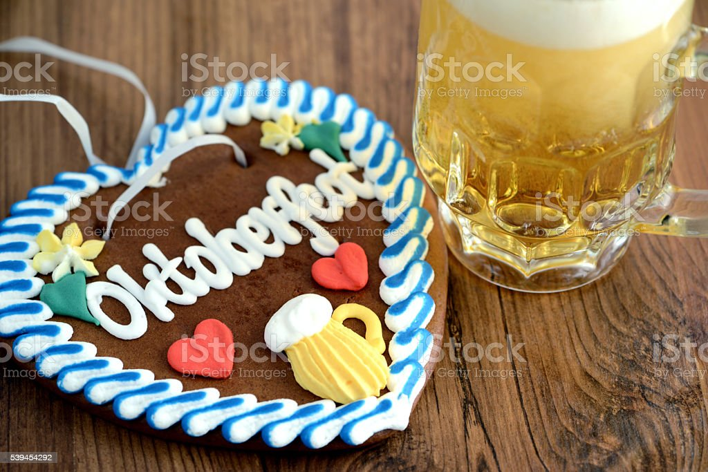 Oktoberfest gingerbread heart with beer on table stock photo
