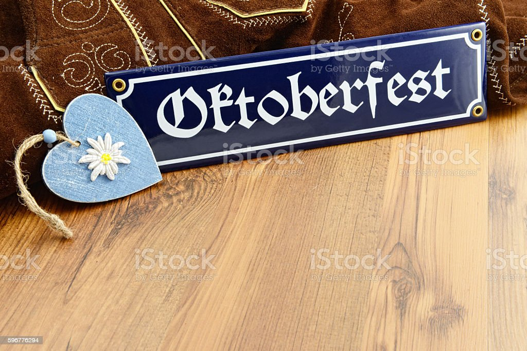Oktoberfest information sign and bavarian  heart and leather pants stock photo