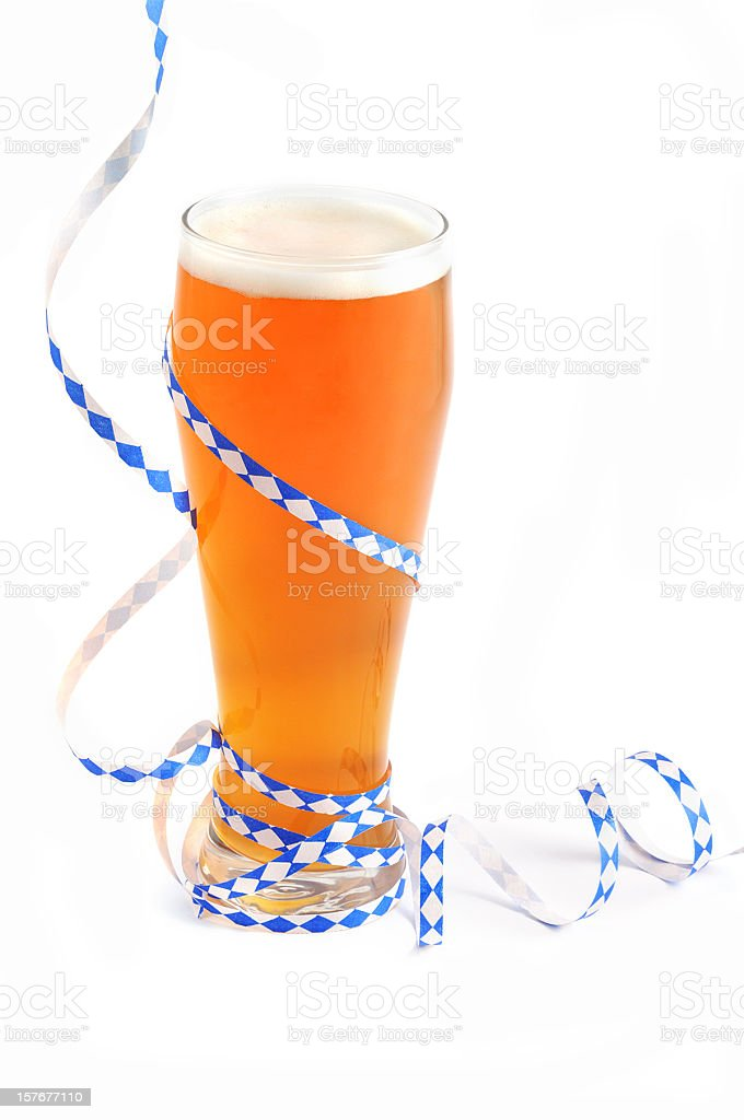 Oktoberfest objects like glass of wheat beer with bavarian streamer royalty-free stock photo
