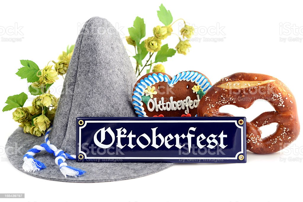 Oktoberfest sign with Gingerbread Cookie hat and pretzel stock photo