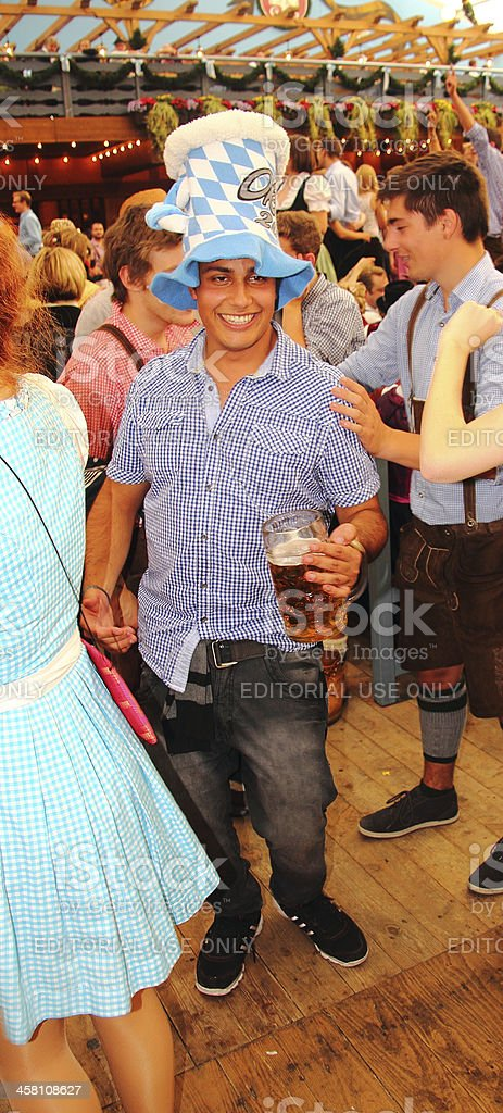 oktoberfest_young man in the beer tent stock photo