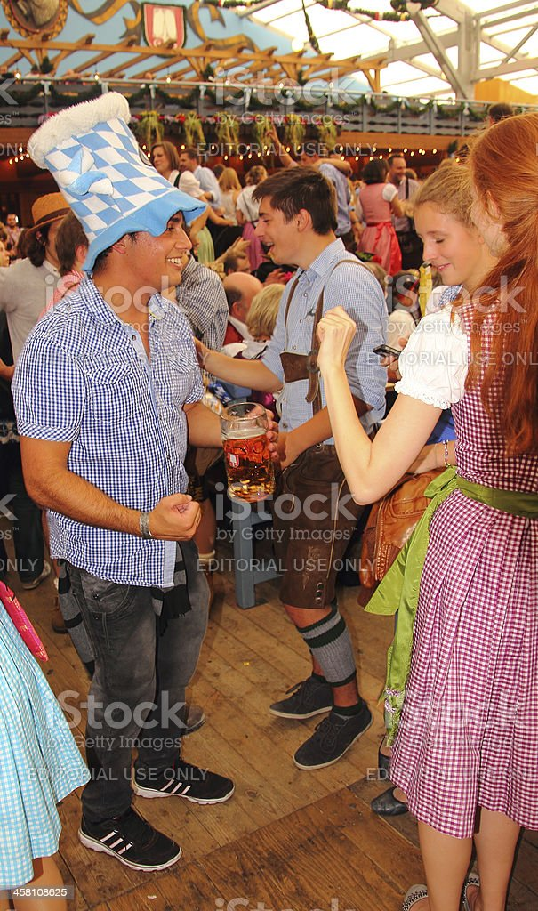 oktoberfest_young people in the beer tent 4 stock photo