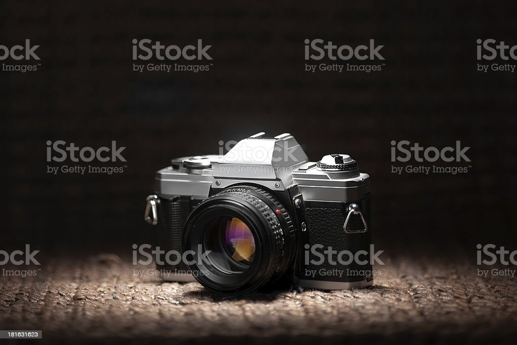 Old 35mm film camera under a spot light royalty-free stock photo