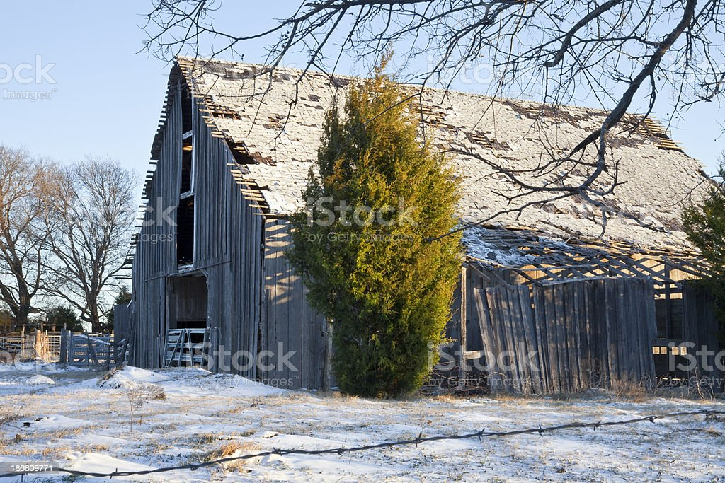 Old Abandoned Barn with snow on ground. royalty-free stock photo