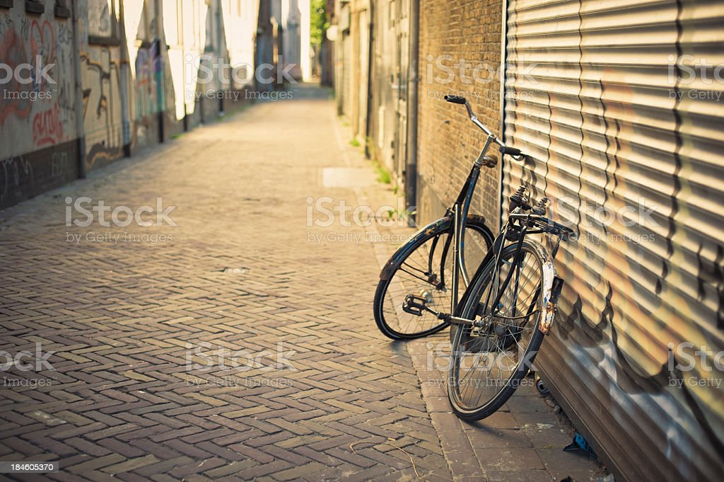 Old Abandoned Bicycle Leaning On The Wall In Delft, Netherlands royalty-free stock photo