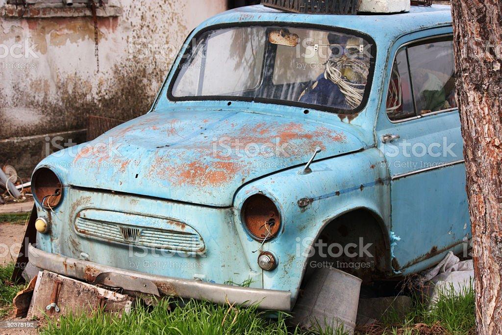 Old abandoned blue car stock photo
