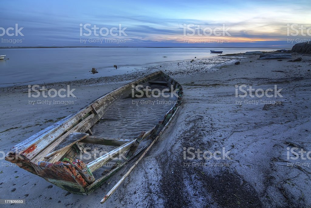Old abandoned broken boat at sea against seascape. royalty-free stock photo