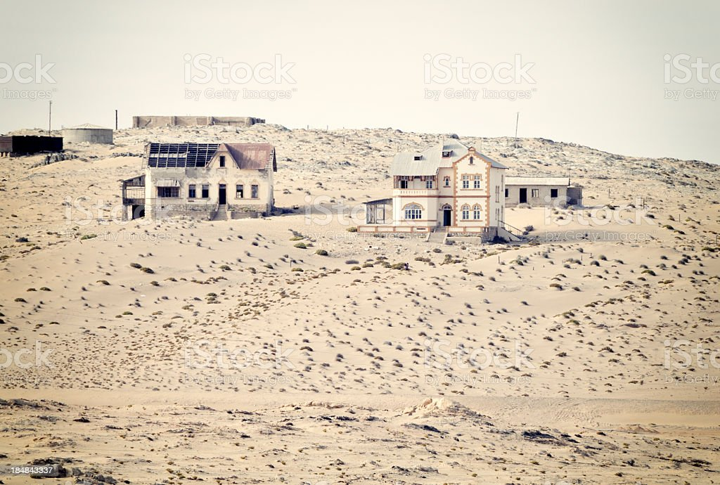 Old, abandoned buildings in a remote, dusty landscape.  stock photo