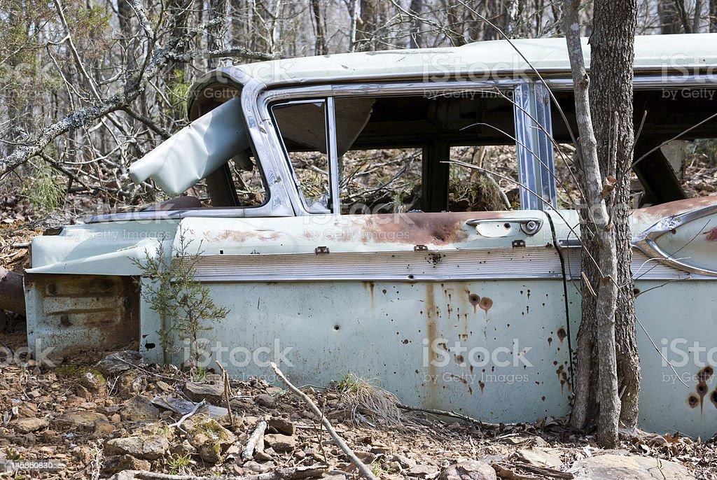 Old abandoned bullet ridden car stock photo