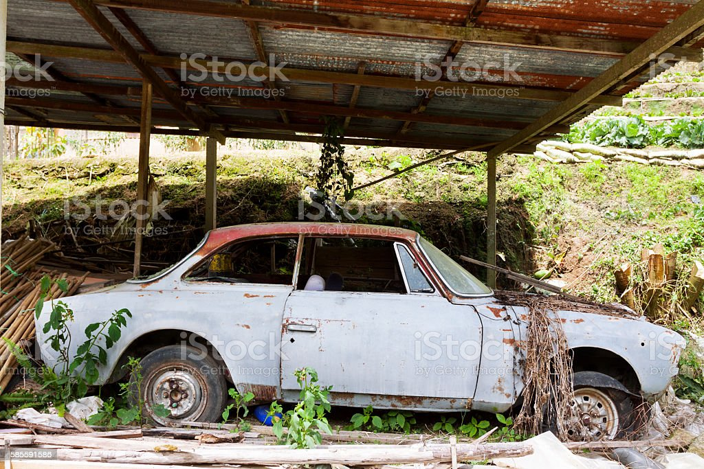 Old abandoned car near farm stock photo
